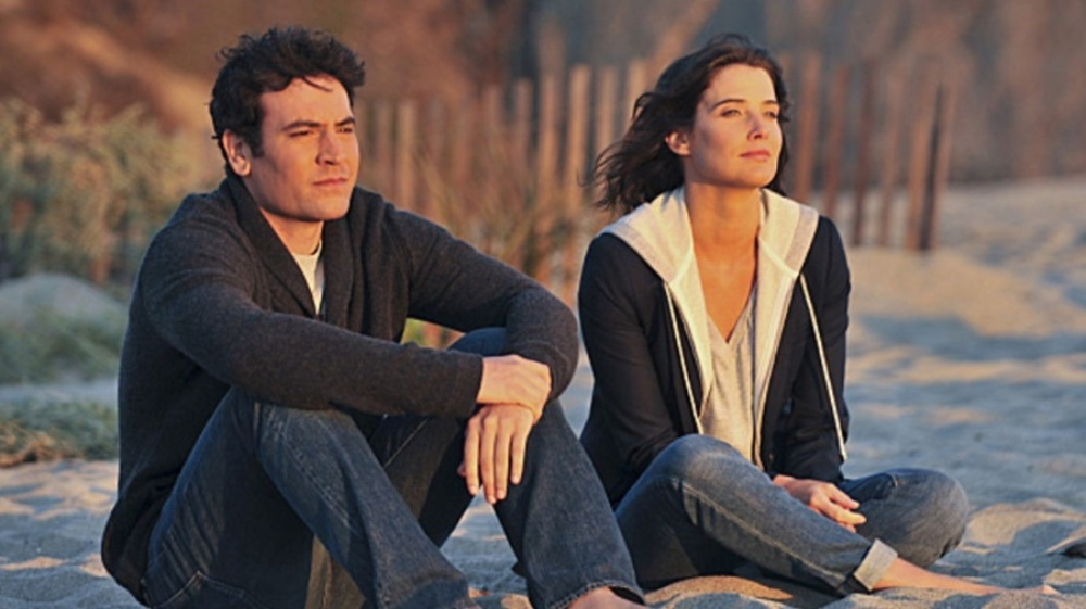 still of ted and robin at the beach