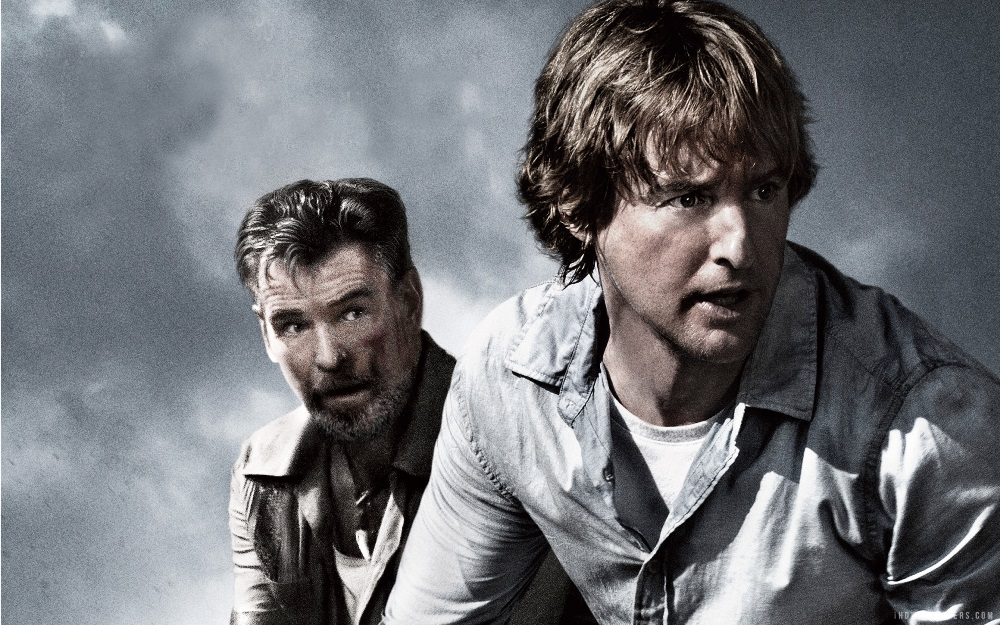 still of owen wilson and pierce brosnan from no escape