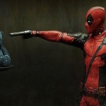 Still of Deadpool pointing a gun at a teddy movie wallpaper
