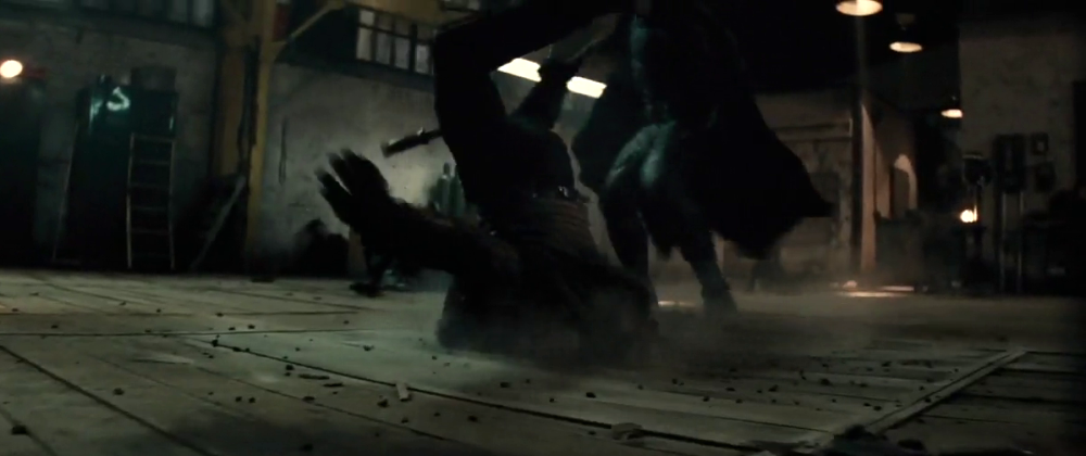 still of Batman delivering a superpunch at a hooligan in Batman v Superman Dawn of Justice