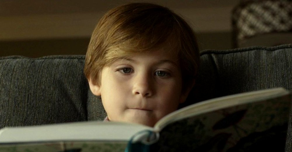 still of jacob tremblay reading a diary in before i wake movie
