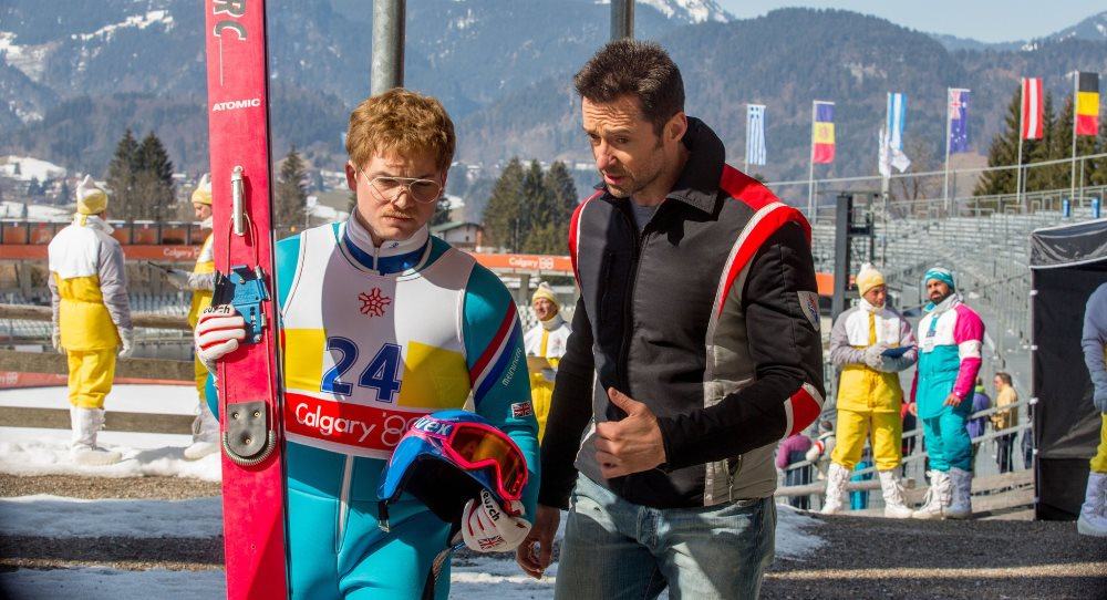 still of Hugh Jackman and Taron Egerton in Eddie the Eagle movie