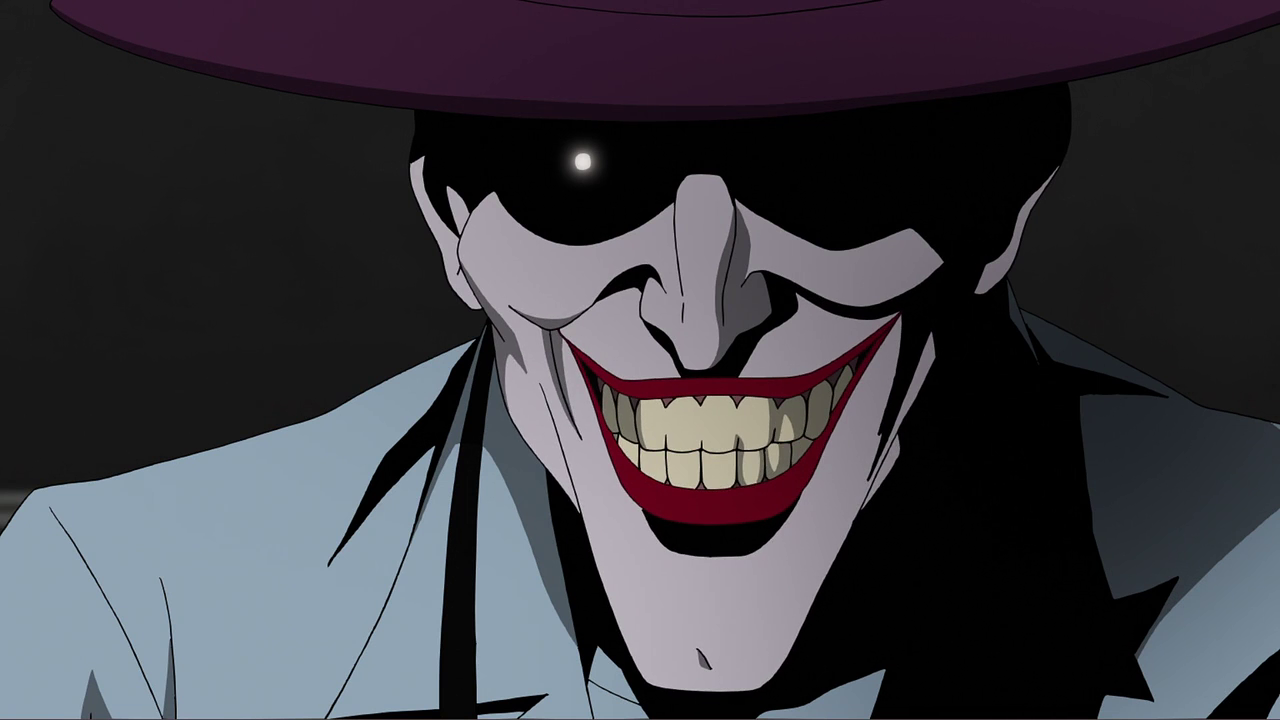 still of the joker with gleaming eyes in batman the killing joke