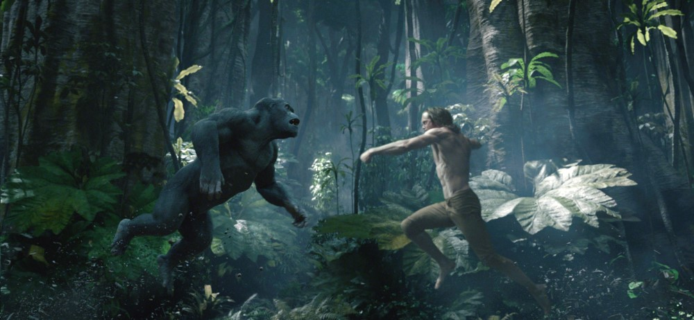 still of Akut and Tarzan fighting in the legend of tarzan movie