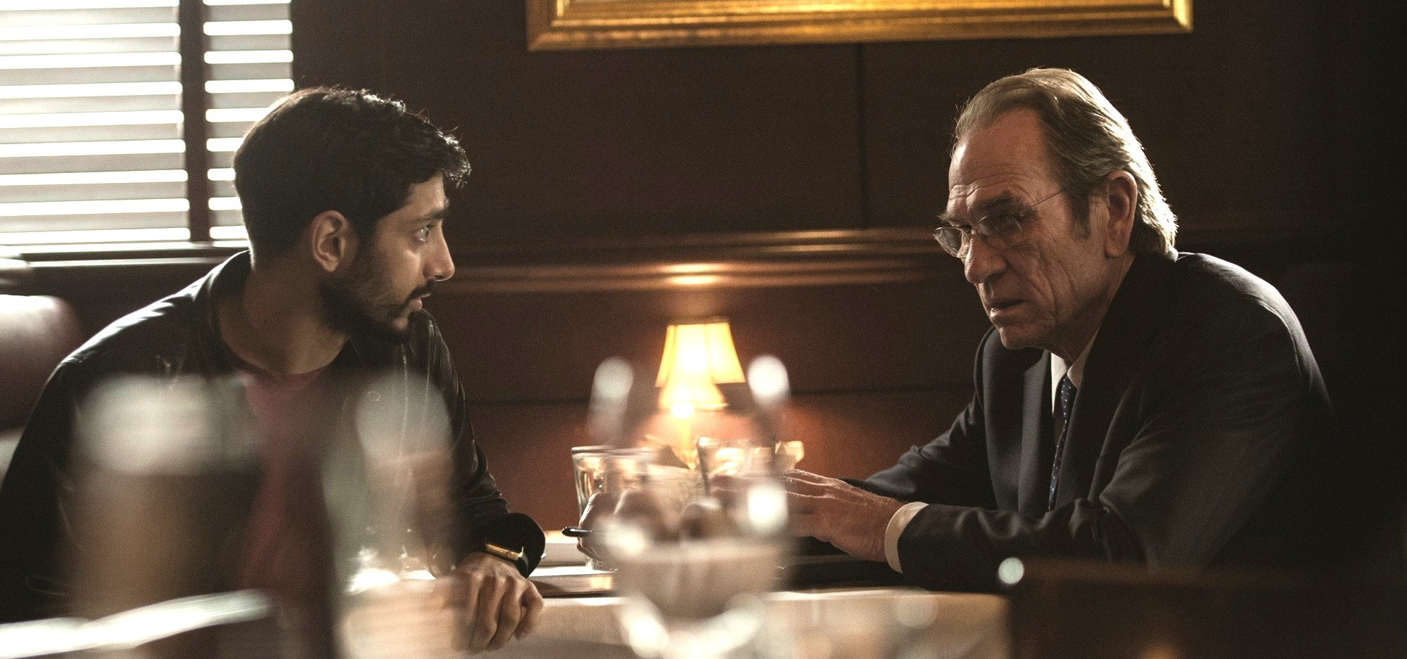 still of Tommy Lee Jones as Robert Dewey and Riz Ahmed as Aaron Kalloor in Jason Bourne