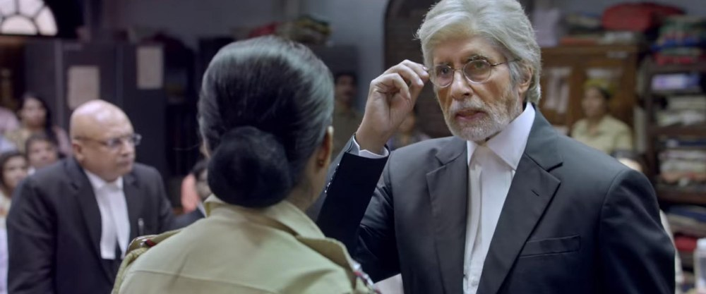 still of amitabh bachchan interacting with a police inspector in pink movie