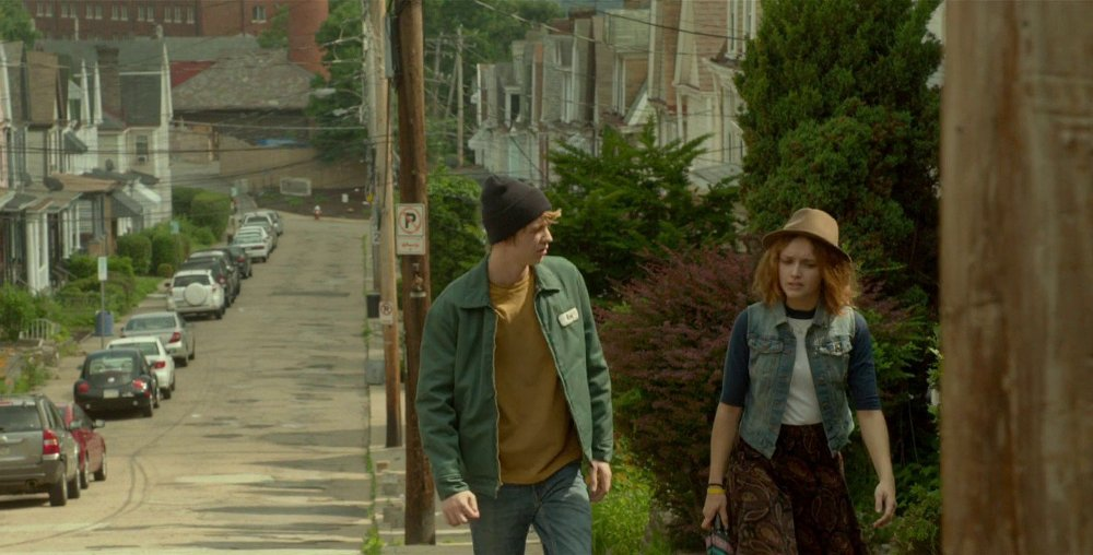 still of greg and rachel walking in me and earl and the dying girl