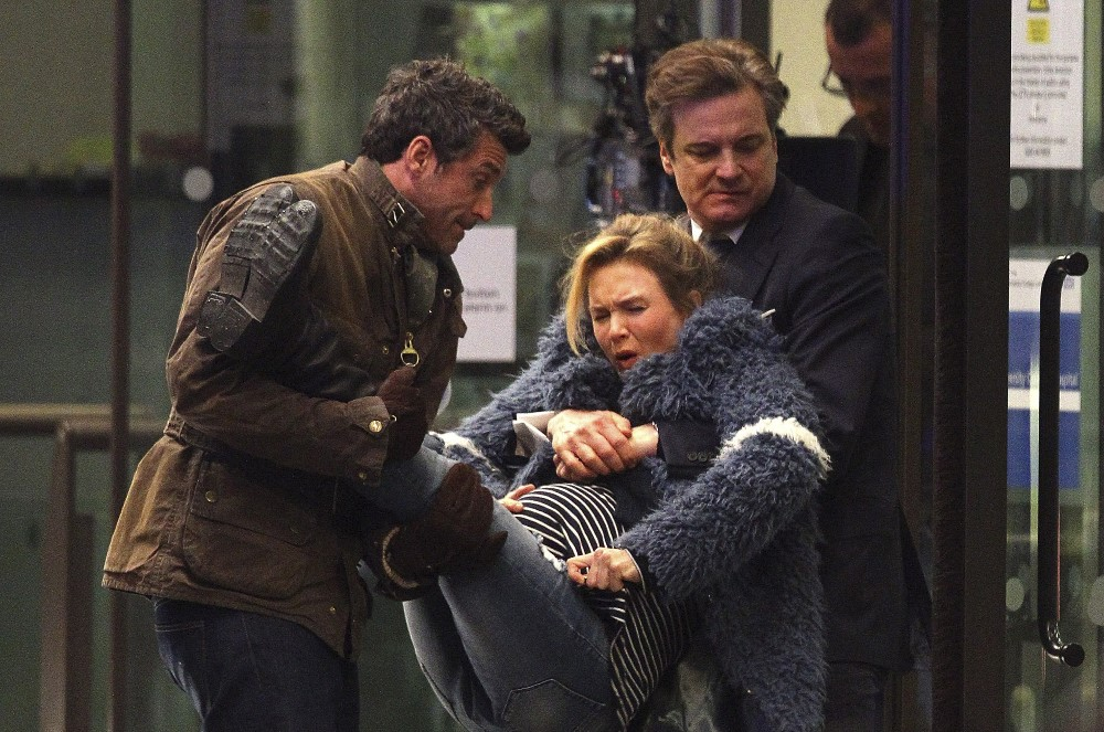 still of Jack and Mark carrying Bridget Jones Baby movie by Sharon Maguire