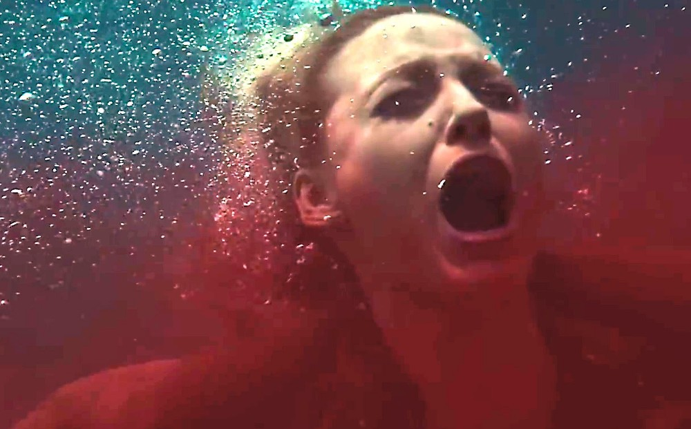 still of blake lively as nancy in pain in the water