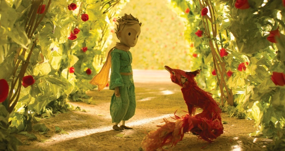 still of the fox and the little prince in a rosebush