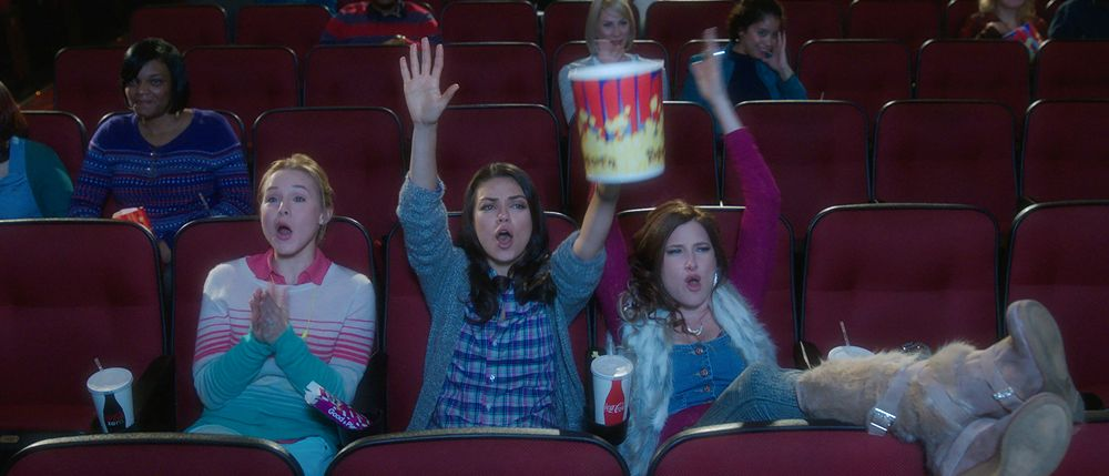 still from bad moms movie watching a movie in a theater