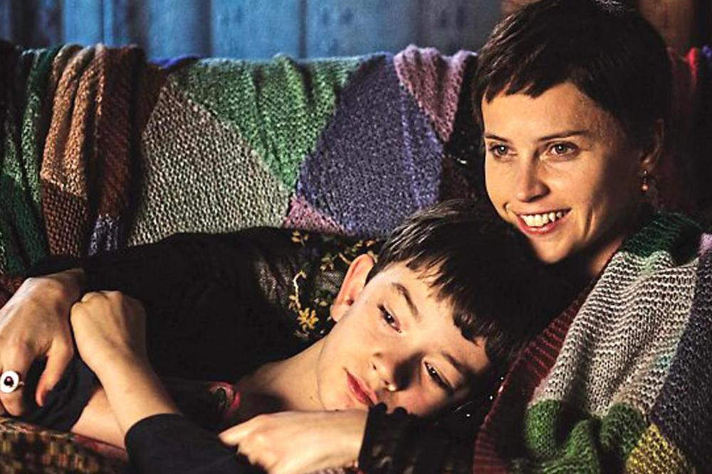 image of felicity jones as mum and Lewis MacDougall as Conor in a monster calls movie