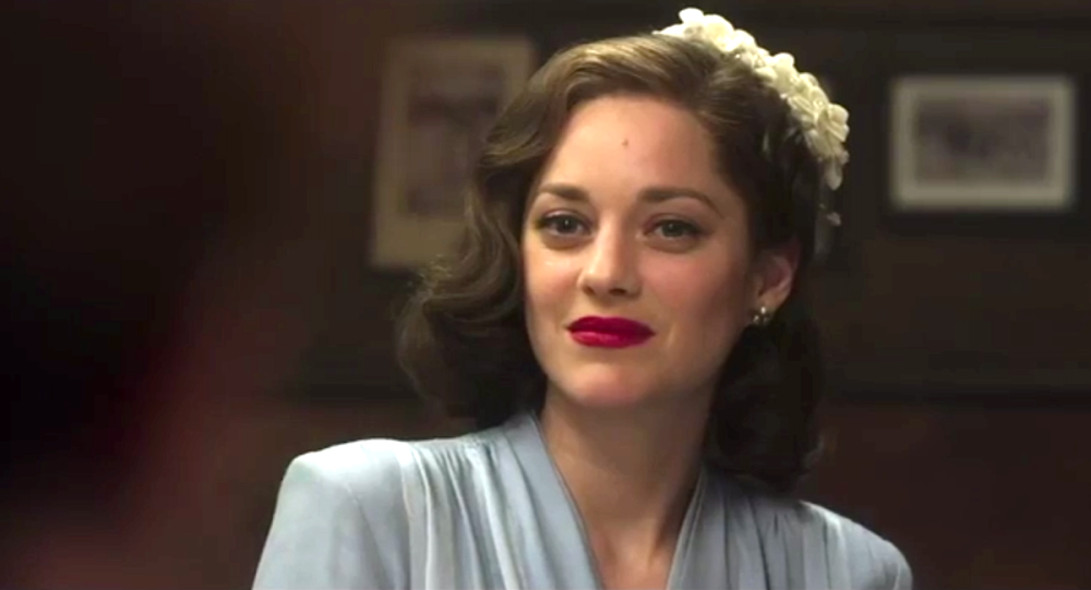 still of a smitten Marion Cotillard in Allied