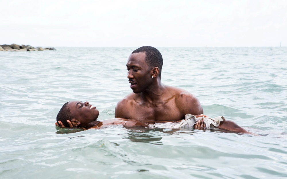 image of Mahershala Ali as Juan teaching Little to swim in Moonlight