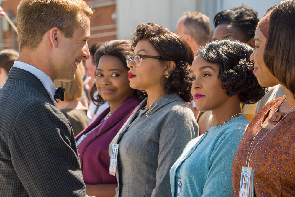 still of john glenn meeting the ladies in hidden figures movie