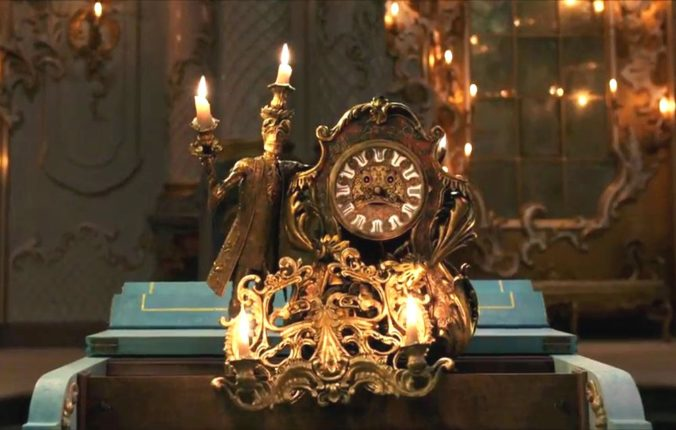 image of lumiere and cogsworth in beauty and the beast