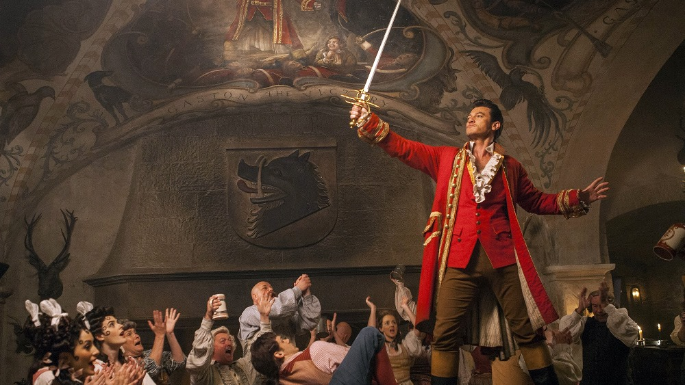 still of luke evans as gaston in beauty and the beast