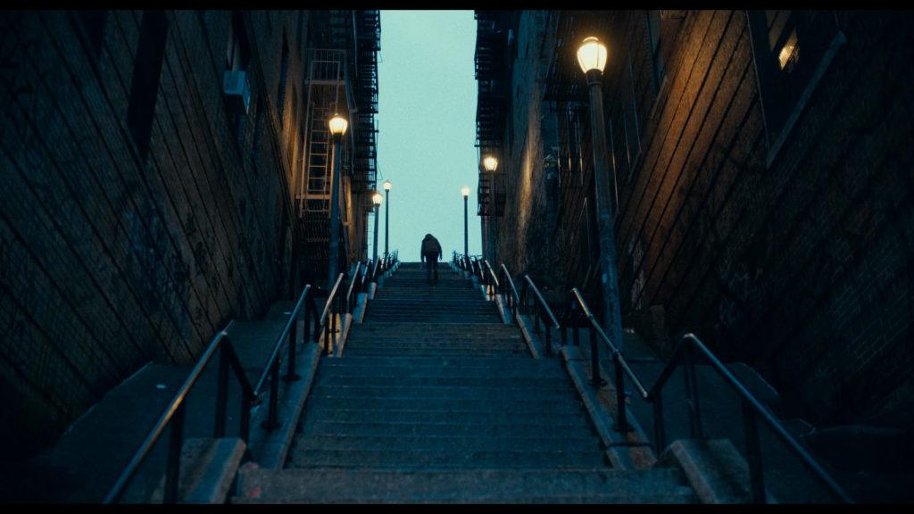 Arthur Fleck Joaquin Phoenix walking on steps